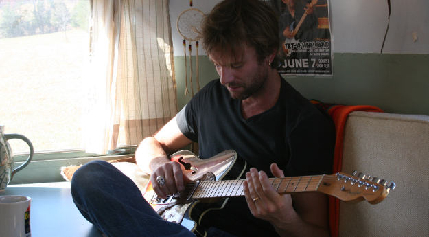 Josh Rogan playing his Fender guitar.