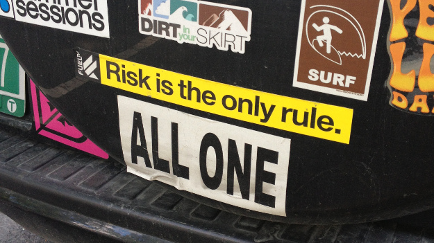 A bumper sticker that says Risk is the only rule
